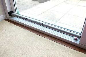 Dual function security door bar